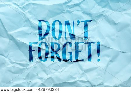 Phrase Don;t Forget Written On Crumpled Blue Paper