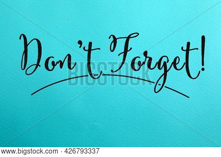 Phrase Don't Forget Written On Blue Paper