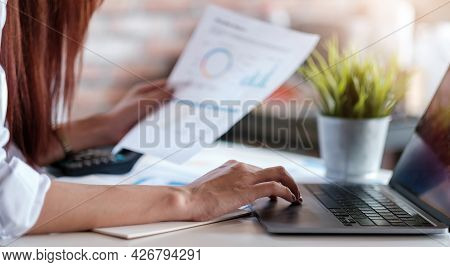 Business Woman Working In Finance And Accounting Analyze Financial Budget At Home , Work From Home C