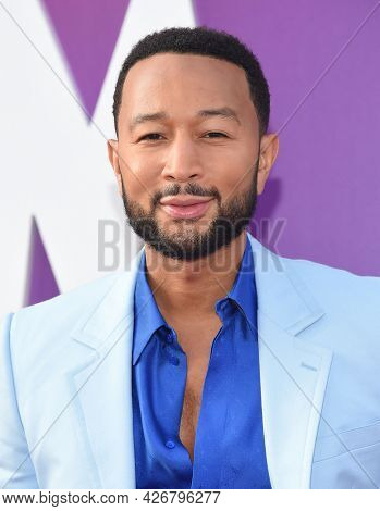 LOS ANGELES - JUL 12: John Legend arrives for the 'Space Jam: A New Legacy' World Premiere on July 12, 2021 in Los Angeles, CA