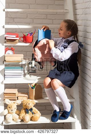 Cute School Girls Packing Their School Bags, Preparing For The First Day Of School. The Morning Scho