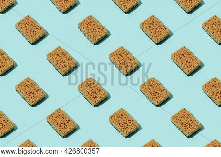 Seamless Pattern With Neutral Beige Clean Sponges For Home Cleaning On Blue Background. Banner For Y
