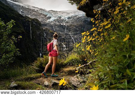 Person Walking To The Rob Roy Glacier In Aspiring National Park, New Zealand