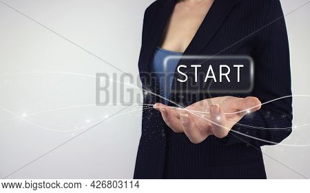 Start Up Business Concept. Power Up Concept. Hand Hold Digital Hologram Start Button On Grey Backgro