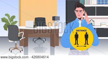 Businessman Holding Round Sign Social Distancing Coronavirus Epidemic Protection Self Isolation Conc