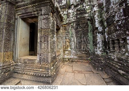 The Low Relief Carvings Surrounding Bayon Castle Belong To The Khmer Empire. Located In The Center O