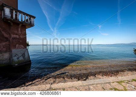 Lago Di Garda. The Lake Garda View From The Small Village Of Lazise, Tourist Resort On The Coast, Ve