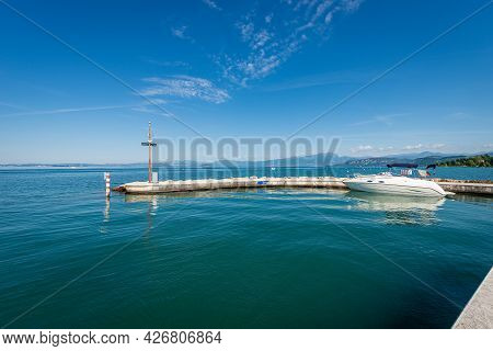 Lake Garda (lago Di Garda) In Front Of The One Of The Two Ports Of The Small Village Of Lazise, Tour