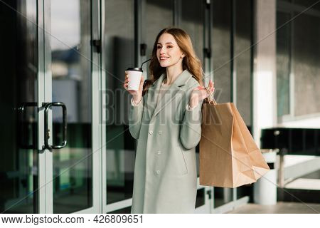 Happy Woman With Shopping Bags Enjoying Shopping. Consumerism, Lifestyle Conception