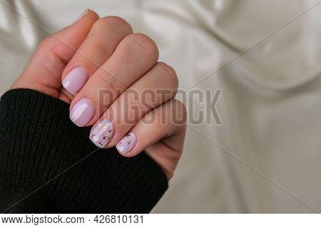 Closeup Elegant Pastel Natural Modern Design Manicure On Fabric Silk Background. Female Hands. Gel N