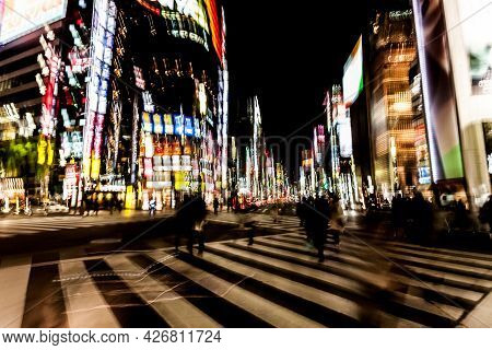 Blurred Motion Of Cars, Abstrakt Motion Blurry Of Big City. Ginza Crossing At Night, Tokyo, Japan