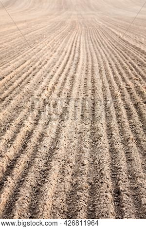 Background Of Newly Plowed Field Ready For New Crops. Ploughed Field In Autumn. Farm, Agricultural B