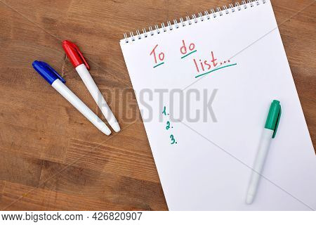A To-do List In A Spiral Notebook On An Isolated Green Background. An Empty Space For The Text. In T