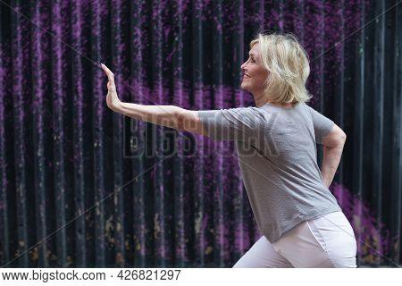 Caucasian Elderly Woman Doing Qigong Exercise Summer Outdoor