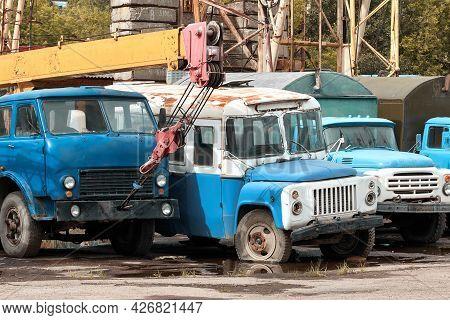 Dump Of Old Soviet Trucks. Old Rusty Soviet Cars