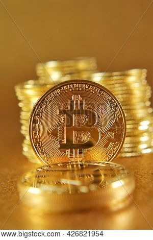 Virtual Currency. Money And Finance. Gold Bitcoin On A Golden Blurred Background. Blockchain Cryptoc