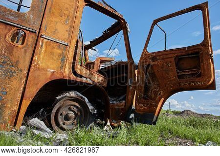 Burnt Truck On The Side Of The Road. Fully Burnt Truck Cab. Rusty Truck Charred From Fire