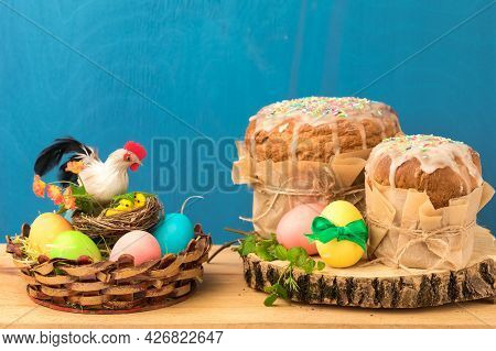 Orthodox Cakes Decorated With Ice Icing, Painted Eggs. Easter Holiday Composition. Eggs Lie In A Bas