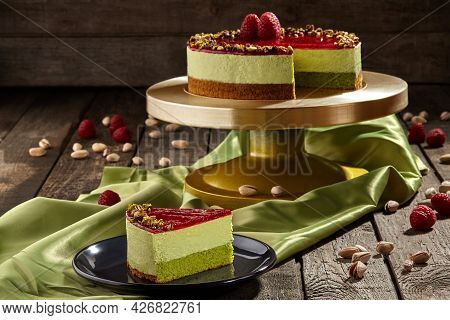 Sliced Pistachio Cheesecake With Raspberry Jelly With Berries