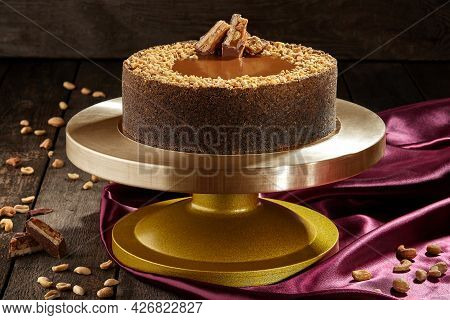 Cheesecake With Salted Caramel, Peanuts And Chocolate Bar