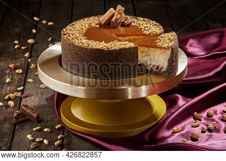 Sliced Cheesecake With Chocolate, Nuts And Salted Caramel