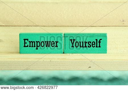 Green Wooden Blocks With The Words Empower Yourself