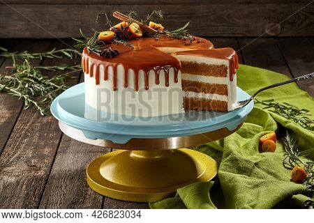 Sliced Carrot Cake With Cheese Cream And Caramel Sauce