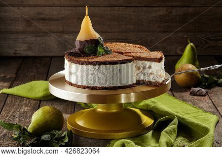 Sliced Cheesecake With Chocolate Shortbread And Poached Pear