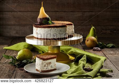 Cheesecake On Chocolate Shortcrust Pastry With Poached Pear