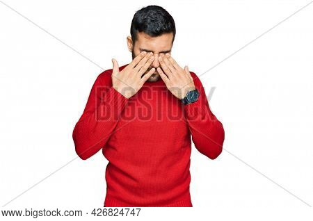 Young hispanic man wearing casual clothes rubbing eyes for fatigue and headache, sleepy and tired expression. vision problem