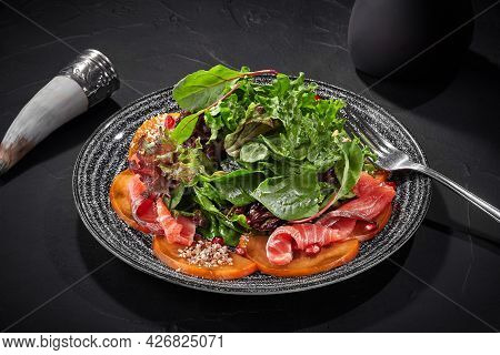 Salad Of Greens, Persimmon And Salted Salmon With Pomegranate And Walnuts