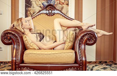Beautiful Young Adult Blond Woman On Sofa