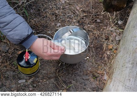 Travel Food For Outdoor Activities. Soup In Bowls On Wooden Logs In The Forest. Camping Food Making.