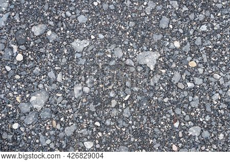 Background Texture Of Asphalt Crumbs With Small Stones