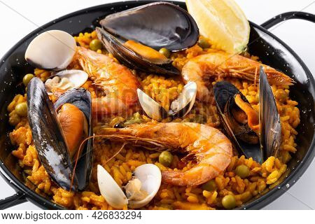 Traditional Spanish Seafood Paella Isolated On White Background