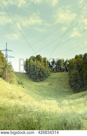 Natural Green Idyllic Background, Beauty In Nature. Forest, Hill, Ravine And Flowering Meadow In Sum