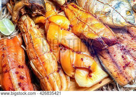 Smoked Fish At The Fish Market. Various Smoked Fish In Seafood Market.