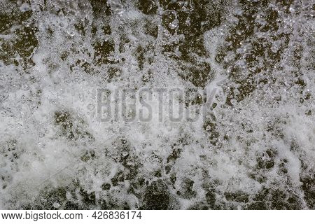 Water Splashes As It Tumbles Over A Waterfall.