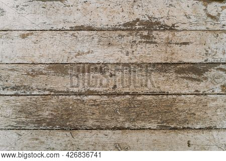 The Texture Of Old Scratched Wood. Gray, Worn Paint On The Wooden Surface. Shabby Wall Background. T