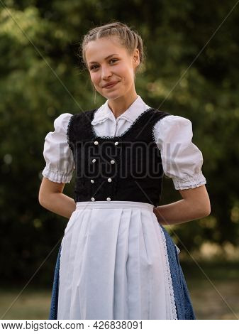Teenager girl in traditional folk clothes