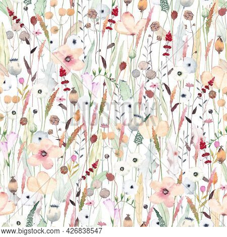 Watercolor seamless pattern with different wild flowers. Cute background for fabric, textile, nursery wallpaper. Meadow with wild flowers.