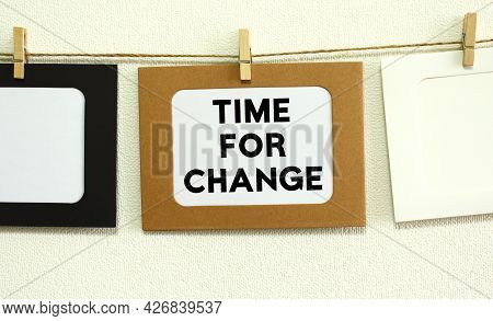 Kraft Paper Frame Hanging On Lacing On White Wall Background With Space. In The Frame Is Written The
