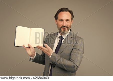 Take A Look, Read A Book. Happy Businessman Show Open Book. Reading Teacher In Formal Suit. School L