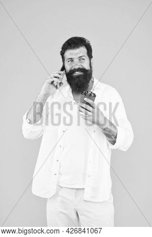 Cheerful Guy With Moustache And Beard Drink Coffee And Talking On Smartphone, Communication
