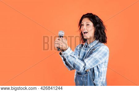 Singing A Song With A Microphone. Having A Party. Happy Woman With Microphone. Karaoke Concept. Sing