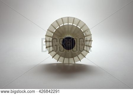 Impeller Of Electric Motor. Round White Plastic Piece