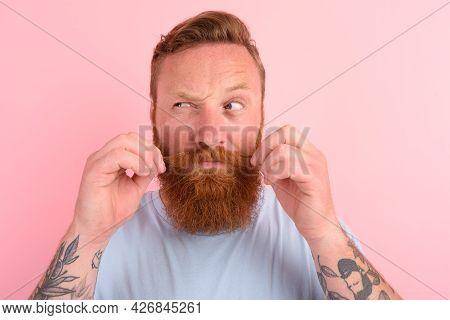 Doubter Man With Beard And Light Blue T-shirt