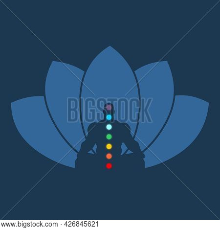 Muscular Man Sit In Meditation Pose With Colored Chakra Points.