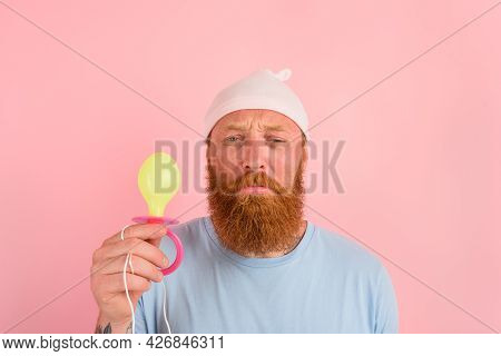 Delusion Man With Beard And Tattoos Acts Like A Little Newborn Baby With Pacifier In Hand