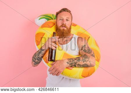 Serious Man Is Ready To Swim With A Donut Lifesaver With Beer And Cigarette In Hand